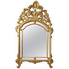 mirror in golden wood in louis xv style