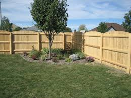 Rustic Privacy Fence With Round Post And 1 2 Log Framing Wood Fence Post Cedar Fence Posts Lawn Decor