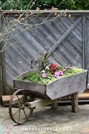 22 Creative Wagon Planter Ideas Whiskey Barrels And Wheels Empress Of Dirt
