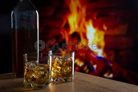 glass of whiskey in front of a