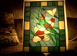 stained glass panels featuring koi