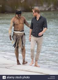 The Duke of Sussex talks to aboriginal 'Song Man' Aaron Henderson on the  shore of Lake McKenzie on Fraser Island, on day seven of the Duke and  Duchess of Sussex's visit to