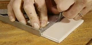 cut ceramic tile with a glass cutter