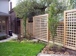 Square Lattice Fence Like This Fence Better Than Plain Wood Fence Much Better Than Chain Link Backyard Fences Backyard Privacy Fence Design
