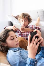 Kids And Mother Using Gadgets In Living Room By Guille Faingold Ebook E Book Stocksy United