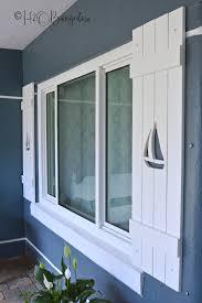 diy shutters with sailboat cutouts