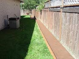 River Rock Fence Border Pictures And Photos Rock Fence Backyard Fences Backyard Plan