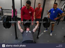 Airman 1st Class Ashton Roberts, 5th Civil Engineer Squadron engineering  assistant, participates in a bench press