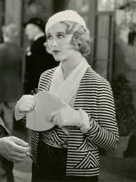 1932 Stripes were fashionable. Beret, small hats the vogue. Bag with large  kiss lock,which is probably celluloid. Note crossed collar on blouse.