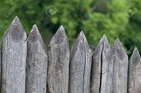 Fence Stakes A Fence Made Of Logs Tapered Wooden Stakes Stock Photo Picture And Royalty Free Image Image 59617047