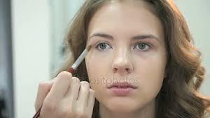 makeup artist making make up for a