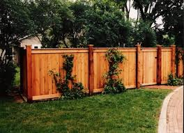 Wood Fence Ideas Tight Slat With Top And Bottom Border Board And Cap Board On Top Capped Higher Posts Lend A More Fence Design Wood Fence Wood Fence Design