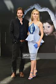 """Aaron Stanford and Amanda Schull attend a photocall for the """"12 ..."""