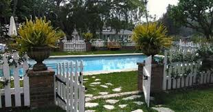 Pin By Amy Coupon On Outdoor Rooms Sunrooms Porches Pool Fence Pool Landscaping Fence Around Pool