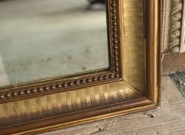 an antique louis philippe style mirror