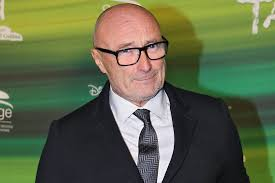 Phil Collins calls Adele a 'slippery little fish' after being dropped from  her new album   NME