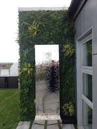 artificial green wall with mirrored