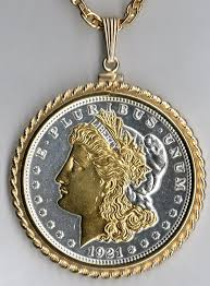 gold and silver on silver morgan dollar