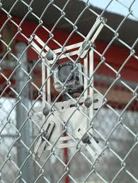 Field Side View Of A Lynkspyder Mounted To A Chain Link Fence Gopro Hero 3 Black Baseball Softball Fi Chain Link Fence Football Helmets Baseball Softball