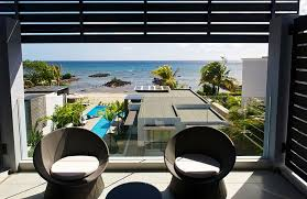 The Charming Wonderful Balcony Design With Modern Patio Furniture Design Decorated With Glass Fence Design And Concrete Floor Tile In Island Resort