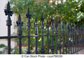 Black Spike Fence Black Metal Spiked Residential Fence Diminishing To Soft Focus In The Distance