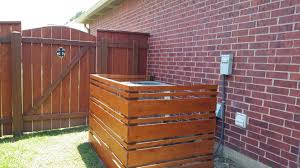 Air Conditioning Enclosure Made From Cedar Fence Boards Front Is Removable For Servicing A C System Cedar Fence Boards Cedar Fence Fence Board Crafts