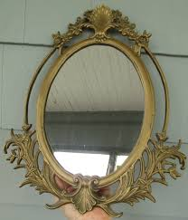 large brass iron oval ornate mirror
