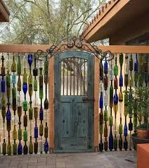 Beautiful Wine Bottle Fence With Restyled Vintage Door As A Gate Diy Yard Wine Bottle Fence Wine Bottle Wall
