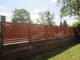 Wooden Slatted Fencing To Be Attached On Top Of A Garden Wall Rock Wall Fencing Garden Wall Retaining Wall Fence
