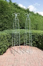 weathered green sy iron garden obelisk