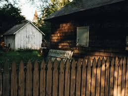And Old Brown Barn With A Wooden Picket Fence In A Small Rural Town In America By Greg Schmigel Stocksy United