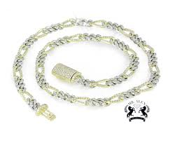 10k two tone figaro diamond chain 15 00
