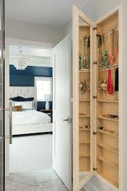 long wall mirror with jewelry
