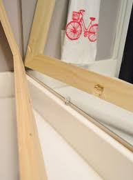 wood frame around a bathroom mirror