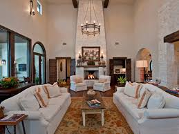 living room with tall stone fireplace