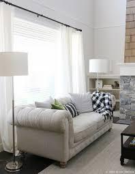 sofa floor lamp behind couch