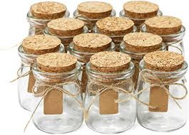 small glass bottles with cork lids