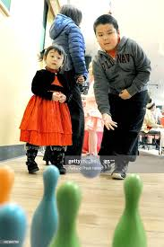 2 yr. old Camila-Vy Pham and 7 yr. old Ben Kieu enjoy bowling during...  News Photo - Getty Images