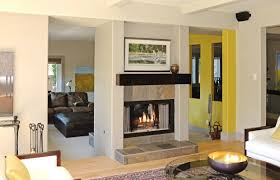 a two sided wood burning fireplace
