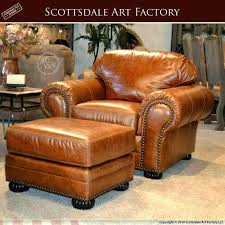 brown leather chair and ottoman for