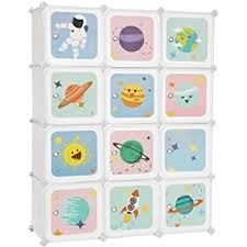 Amazon Com Songmics Kids Toy Cube Storage Organizer 12 Cube Plastic Storage Unit With Doors For Closet Kid S Room Living Room Shoes Clothes Toys Easy To Assemble Stellar Motifs White Ulpc901w Furniture Decor