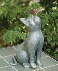 cat statue with erfly ok it s