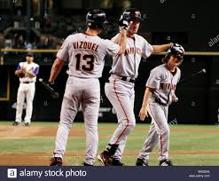 San Francisco Giants Steve Finley is met at home plate by Omar Vizquel and Austin  Finley after Finley hit a lead off home run against the Arizona  Diamondbacks in Phoenix, AZ June