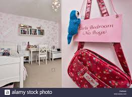 A Cute Pink Sign Hanging In Kids Room With A Childs Hanbag Plush Stock Photo Alamy