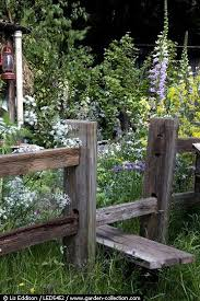 Native Planting In A Cottage Garden With A Stile Over The Fence Cottage Garden Rustic Gardens Native Garden