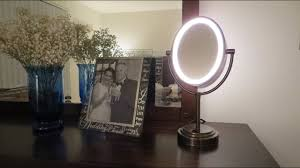 conair oval lighted mirror bronze