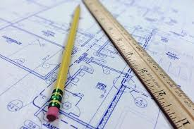 pencil at the top of floor plan paper