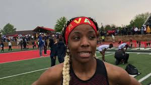 East Kentwood junior Ava Young claims MHSAA 100 meter title - YouTube