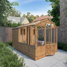 greenhouse and wooden storage shed