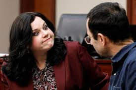 Attorney Shannon Smith smiles at her client Larry Nassar, a former team USA  Gymnastics doctor who pleaded guilty in November 2017 to sexual assault  charges, in the courtroom during his sentencing hearing